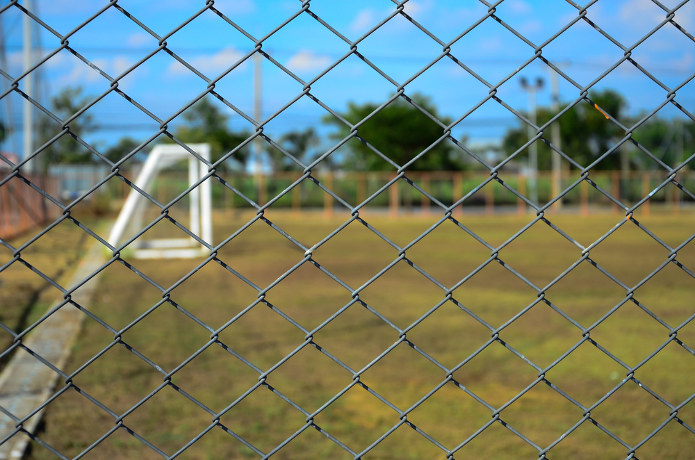 chainwire fence outside a football pitch