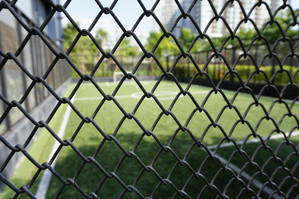 chainwire fencing around a soccer pitch